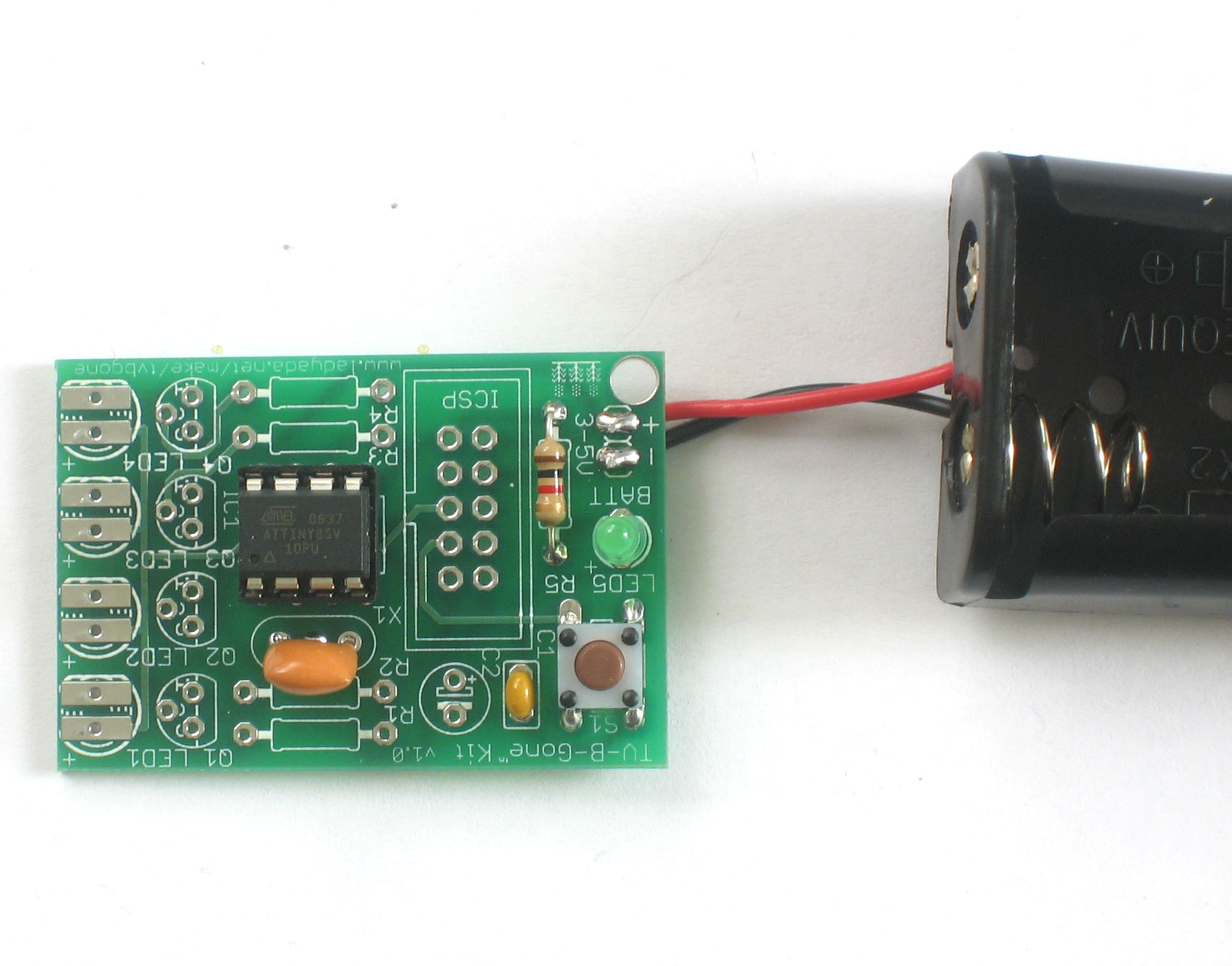 Tv B Gone Kit Diy Universal Remote Printed Circuit Board Of Transistors Capacitors And Other Components Carefully Insert The Microcontroller Into Socket Make Sure That Little Dot Triangle Are At End With Notch In